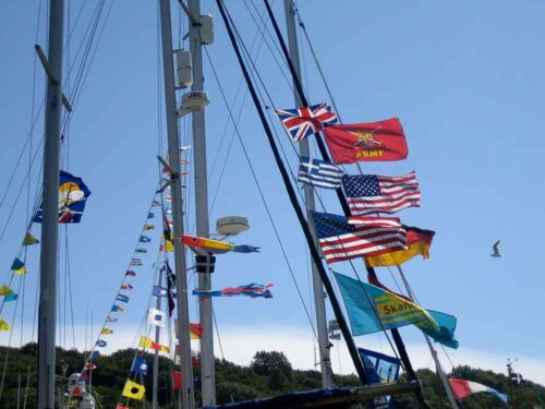 Views of flags on the river at Fowey Cornwall
